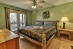King master bedroom on the main level with access to the deck, 32 inch TV, and private bathroom