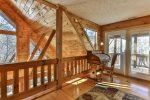 Loft with access to the upper level deck