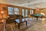 Terrace level living area with with pool table and 42 inch TV