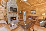 Great room with wood burning fireplace and 43 inch TV
