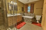 Private bathroom on upper level with luxury shower and jetted tub
