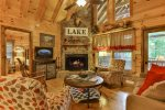 Great room with 32 inch TV and wood burning fireplace