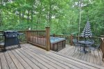 Secluded and private but gorgeous deck with grill, hot tub and dining area