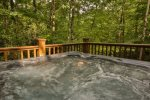 Hot tub surrounded by the woods