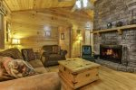 Living area with wood burning stacked stone fireplace