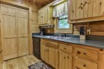 Plenty of counter space to make any meal in this cottage style kitchen