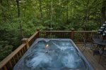 Relax in the hot tub that comfortably seats 4
