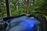 Relax in this bubbling hot tub and feel secluded as you melt your worries away.