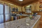 Spacious kitchen with everything stainless appliances and granite