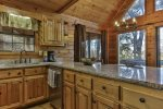 Spacious kitchen with stainless appliances and granite