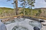 Let the views and hot tub soothe away the stresses of you week