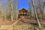 Back of Lakeside Getaway with stairs leading to the fire pit and lake