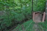 Detached deck to enjoy the creek view and sounds