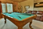 Lower level pool table in game room
