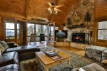 Gather around the stone fireplace or watch a movie