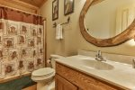 Main level bathroom with tub/shower combo