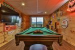 Game room with pool table and arcade games