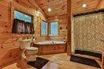 Private upper level bathroom with jetted tub and shower