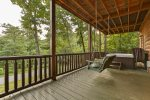 Hot tub and porch swing outside terrace level king bedroom