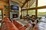 Screened in outdoor seating and fireplace