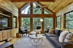 Living room with forest backdrop