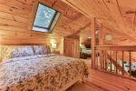 Outside dining on screened in deck with seating for 4