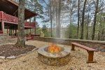 Fire pit with views at the side of the cabin