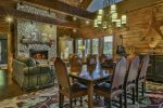 Open dining with wood-burning fireplace