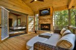 Come relax by the wood burning fireplace on main level deck