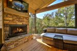 Outdoor wood burning fireplace main level deck