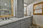 Master bathroom with double vanity and custom walk in shower
