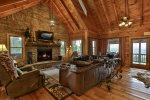 A lavish family room with fireplace beckons you