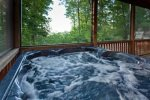 Hot Tub in a screened-in porch overlooking the mountain tops