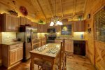 fully equipped kitchen with dining room table