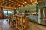 Kitchen and dining area offer excellent views