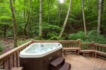 Hot Tub overlooking the fire pit and mountains