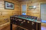 Game room with a foosball table and dart board
