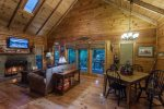 Dining area opens to great room with beautiful creekside views