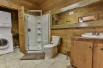 Bathroom on terrace level with walk in shower and laundry facility
