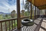 Tire swing on terrace level covered deck