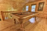 Pool table in the loft area with a flat screen TV