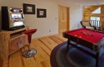 Game room with bumper pool and a slot machine