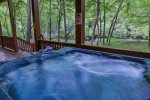 View of the Cartecay River from the terrace level hot tub