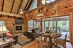 Great room with a gas fireplace that overlooks the the river