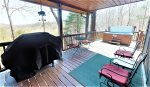 Deck with grill, seating, hot tub and views