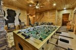 Terrace level game room with a 42 inch flat screen TV