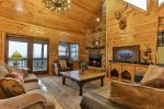 Great Room with a gas fireplace overlooking the mountains