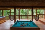Bumper pool table, hot tub and swings