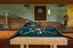 Outside bumper pool table and dart board