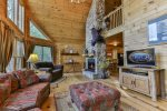 Great Room with a wood burning fireplace and TV